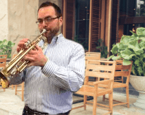 A trumpet player performing outside