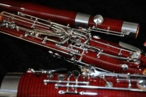 Bassoon parts laying on a floor