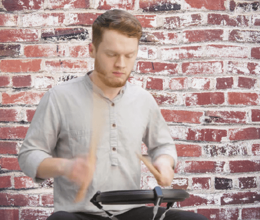 Beginner player practicing in a drum pad