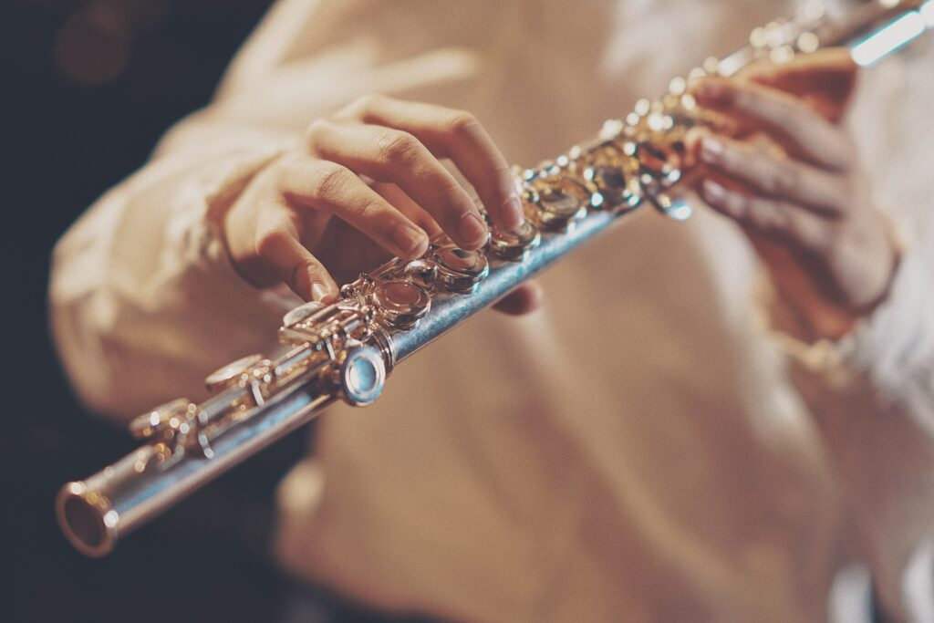 A closeup of a clarinet player performing