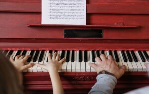 Little girl learning the piano