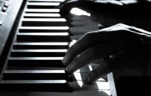 Piano and a player's two hands