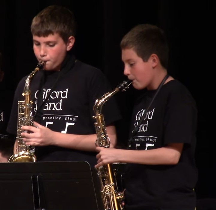 Two saxophone student players performing