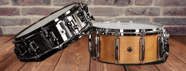 Snare drums one above other