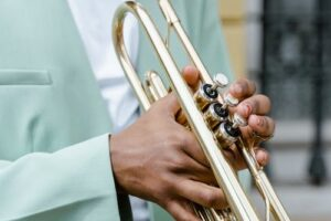 Trumpet player holding the instrument