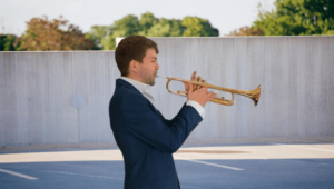 Trumpet player performing outside
