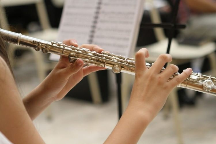 a flute player playing in a concert