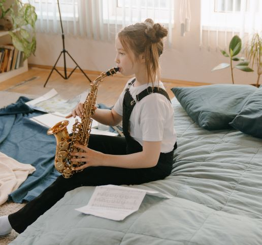 child playing the saxophone
